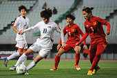 Ra Un Sim of North Korea and Chuong Thi Kieu of Vietnam compete for the ball during the AFC Women's Olympic Final Qualification Round match between...