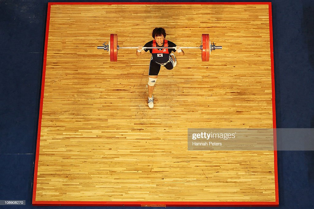 Ra Yu Mun of Korea competes in the Women's Weightlifting 63kg competition during day four of the 16th Asian Games Guangzhou 2010 at Dongguan Gymnasium on November 16, 2010 in Guangzhou, China.