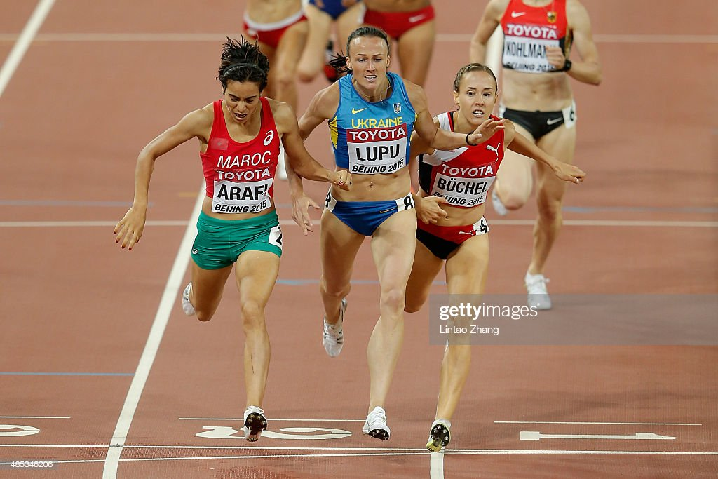 Rababe Arafi of Morocco, <a gi-track='captionPersonalityLinkClicked' href=/galleries/search?phrase=Nataliia+Lupu&family=editorial&specificpeople=6144530 ng-click='$event.stopPropagation()'>Nataliia Lupu</a> of Ukraine and Selina Buchel of Switzerland cross the finish line in the Women's 800 metres semi-final during day six of the 15th IAAF World Athletics Championships Beijing 2015 at Beijing National Stadium on August 27, 2015 in Beijing, China.