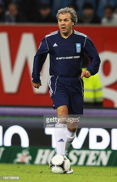 Rabah Madjer of the team Ronaldo Zidane Friends controls the ball during the 'Match Against Poverty' match at Imtech Arena on December 13 2011 in...
