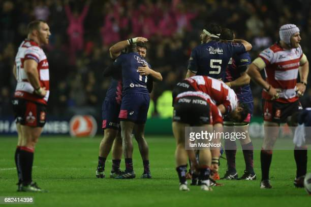Rabah Slimani and Djibril Camara of Stade Francais celebrate their team's 2517 victory during the European Rugby Challenge Cup Final between...