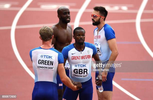 Rabah Yousif Dwayne Cowan Jack Green and Martyn Rooney of Great Britain react after competing in the Men's 4x400 Metres Relay heats during day nine...