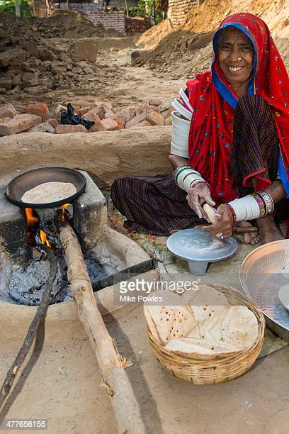 Rabari woman, cooking, Rajasthan, India
