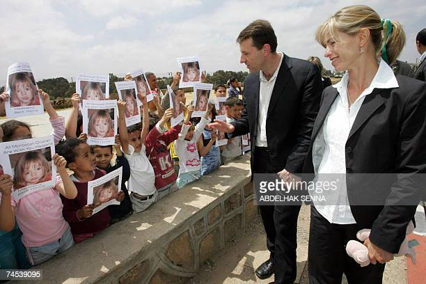 Parents of Madeleine McCann the British girl who vanished in Portugal more than a month ago Gerry and Kate McCann are greeted by Moroccan children...