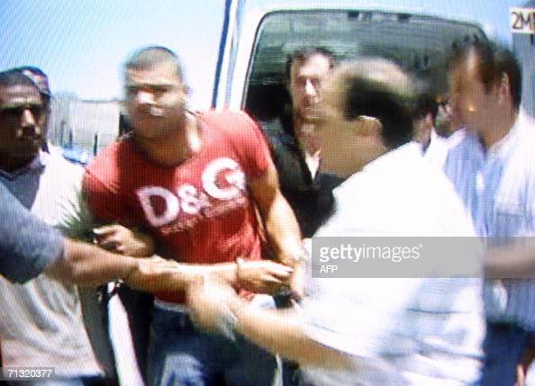 TV grab shows Moroccan policemen escorting Lee Lamrani Ibrahim Murray a man described as both British and Moroccan arrested on suspicion of...