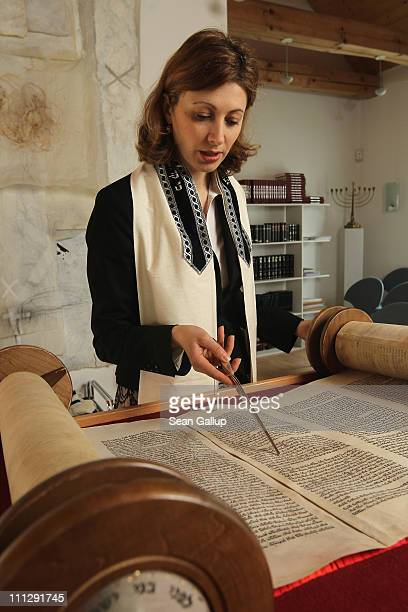 Rabbi Alina Treiger sings as she reads from a torah scroll in the small synagogue on March 31 2011 in Oldenburg Germany Treiger is Germany's first...