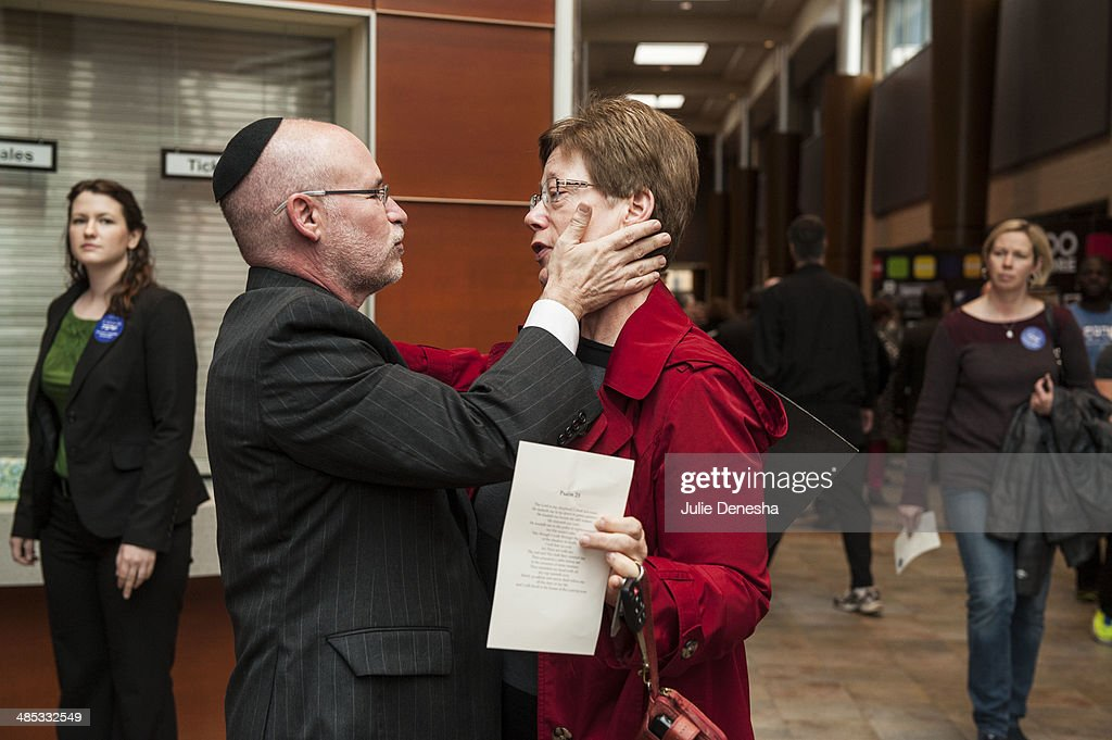Rabbi Arthur Nemitoff, senior Rabbi of The Temple, Congregation B'nai Jehudah, offers words of comfort to Sue Thompson after an interfaith service honoring victims of Sunday's shootings on April 17, 2014 at the Jewish Community Center of Greater Kansas City, in Overland Park, Kansas. White supremacist Frazier Glenn Cross is in custody, charged with murder in the killing of two people outside the center and a third victim at a nearby Jewish retirement home on April 13.