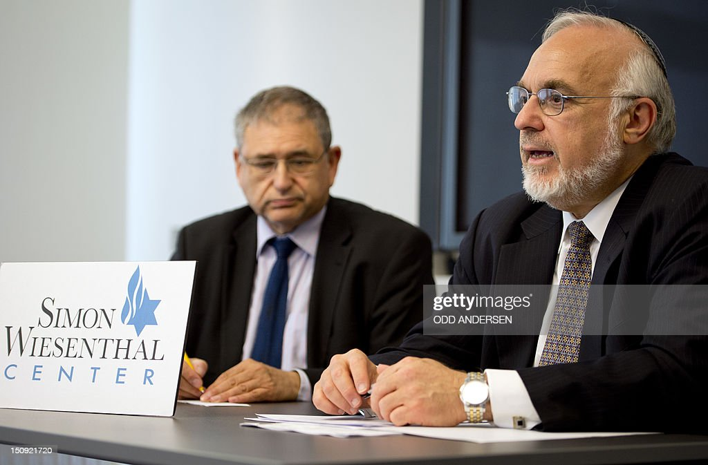 Rabbi Cooper (R), Associate Dean of the Simon Wiesenthal Center and Dr. Shimon Samuels, Director for International Affairs speaks at a press conference in Berlin on August 29, 2012. Cooper and Samuels met with the German Justice Minister, Sabine Leutheuser-Schnarrenberger earlier to discuss the fall out of the ruling of a German judge which declared ritual circumcision illegal.