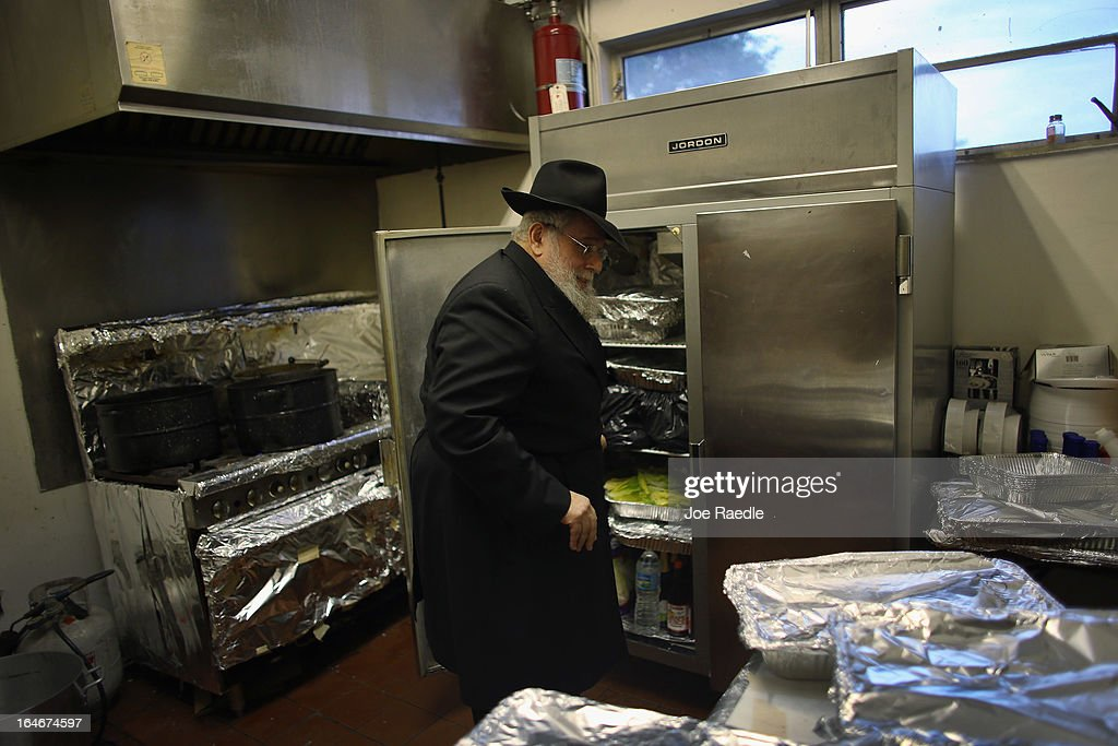 Rabbi Efraim Katz checks on the kosher food in the kitchen as he leads a community Passover Seder at Beth Israel synagogue on March 25, 2013 in Miami Beach, Florida. The community Passover Seder that served around 150 people has been held for the past 30 years and is welcome to anyone in the community that wants to commemorate the emancipation of the Israelites from slavery in ancient Egypt.