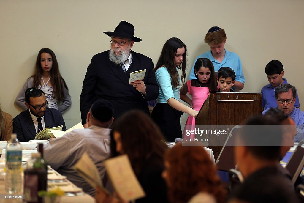 Rabbi Efraim Katz leads a community Passover Seder at Beth Israel synagogue on March 25, 2013 in Miami Beach, Florida. The community Passover Seder that served around 150 people has been held for the past 30 years and is welcome to anyone in the community that wants to commemorate the emancipation of the Israelites from slavery in ancient Egypt.