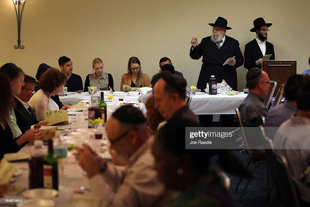 Rabbi Efraim Katz (2nd R) leads a community Passover Seder at Beth Israel synagogue on March 25, 2013 in Miami Beach, Florida. The community Passover Seder that served around 150 people has been held for the past 30 years and is welcome to anyone in the community that wants to commemorate the emancipation of the Israelites from slavery in ancient Egypt.