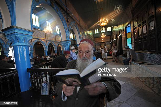 Rabbi Frazi Mazouz reads the Torah on April 29 2010 on the eve of the Jewish annual pilgrimage at the Ghriba synagogue in Djerba This week marks the...