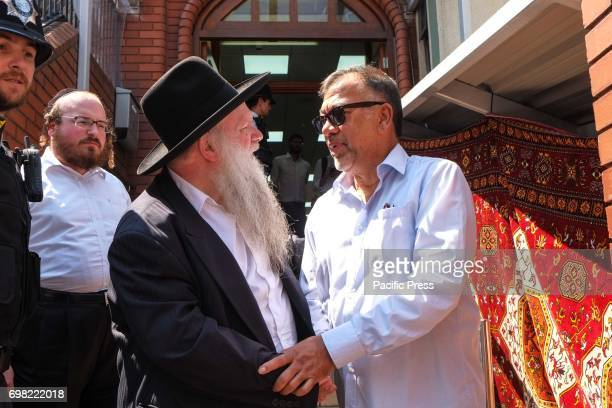 Rabbi Herschel Gluck OBE shake hands a member of the Finsbury Park mosque The night before a man drove a white van into a group of people on their...