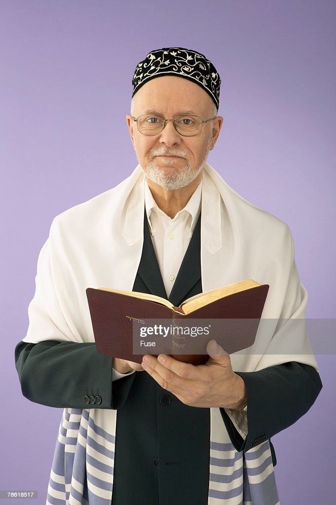 Rabbi Holding Book of Prayers