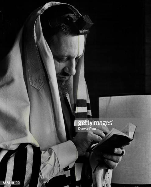 Rabbi Immanuel Jakobovits Of England Performs Ritual Of His Religion On his head and wrapped around an arm is phylacteries a leather box and thongs...