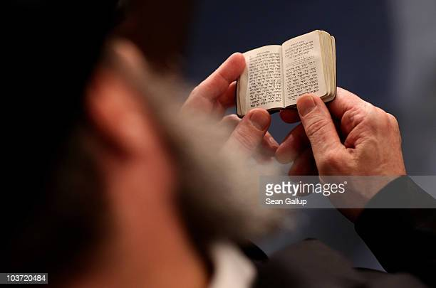 A rabbi reads a psalm book prior to the ordination of new Rabbis Shlomo Afanasev and Moshe Baumel at the Brodyer Synagogue on August 30 2010 in...