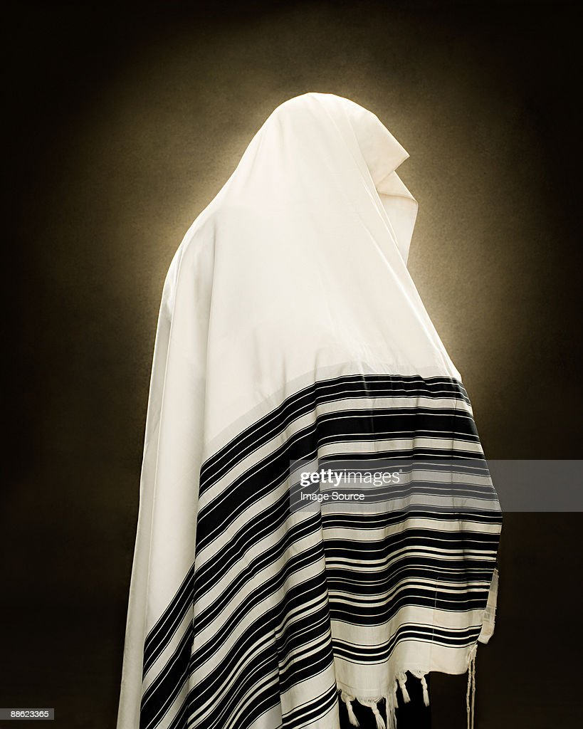 A rabbi wearing a prayer shawl : Stock Photo