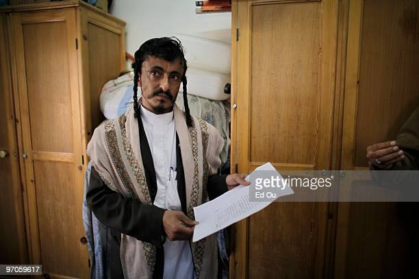Rabbi Yahya Yusuf displays a warning letter he received threatening him and the Jewish community in Yemen inside a protected compound in Sana'a named...