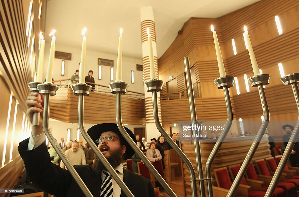 Rabbi Yehuda Teichtal lights a menorah on the sixth day of Hanukkah at the Orthodox synagogue at the ChabadLubavitch Jewish Education Center on...