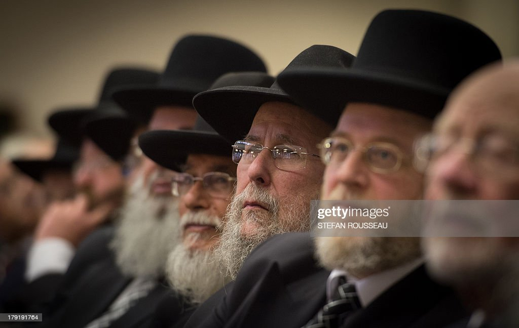 Rabbis and members of the Orthodox Jewish community attend the Installation of Chief Rabbi Ephraim Mirvis as the 11th Chief Rabbi of the United Hebrew Congregations of the UK and the Commonwealth during a ceremony at the St John's Wood Synagogue in north London on Spetember 1, 2013. AFP Photo / POOL / STEFAN ROUSSEAU