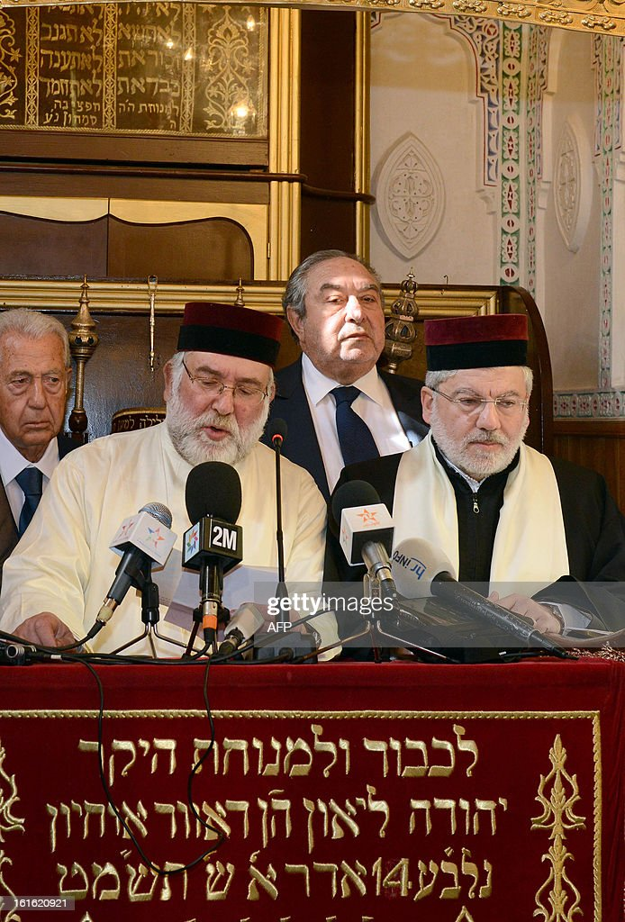 Rabbis pray as the Mayor of Fez and Secretary General of the Istiqlal Party, Hamid Chabat (C-back) listens on during the inauguration of the Slat Alfassiyine synagogue in the northern city of Fez, on February 13, 2013. The two-year restoration of the 17th century synagogue bore 'eloquent testimony to the spiritual wealth and diversity of the Kingdom of Morocco and its heritage,' Moroccan King Mohammed said in a message read by the country's Prime Minister Abdelilah Benkirane.