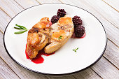 Rabbit in blackberry sauce with rosemary and thyme