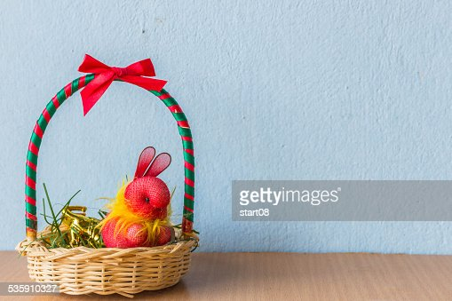 Rabbit in the gift basket : Stock Photo