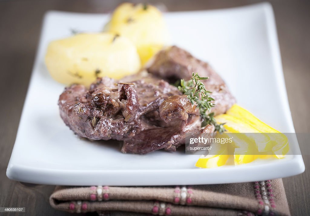 Rabbit meat with winy sauce : Stock Photo