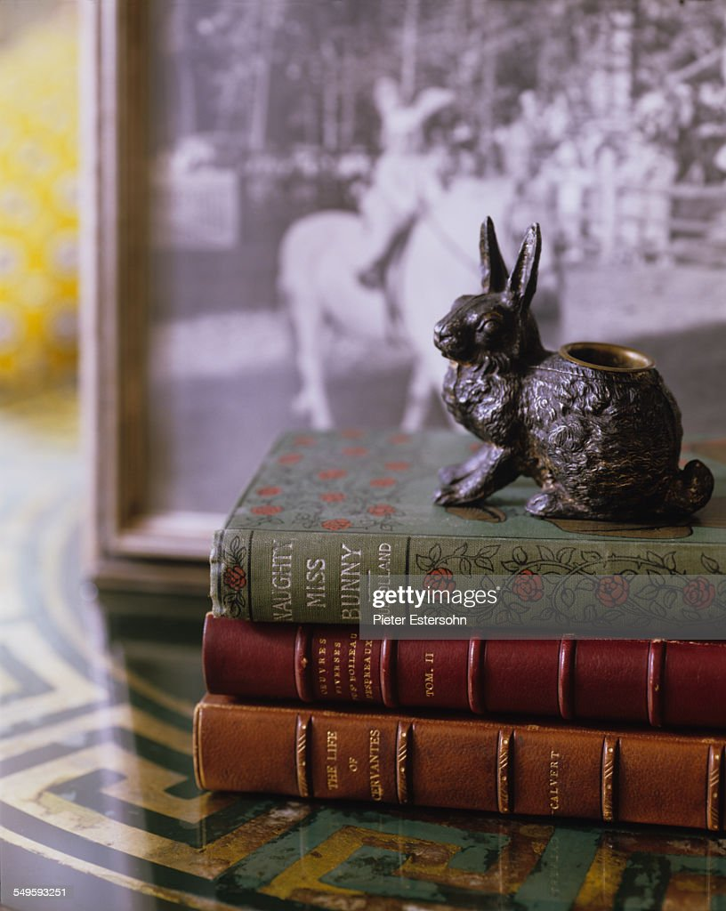 Rabbit paperweight on top of three books