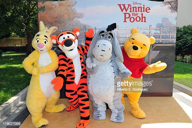 Rabbit Tigger Eeyore and Winnie the Pooh pose at Walt Disney Pictures presents the premiere of 'Winnie The Pooh' at Walt Disney Studios on July 10...