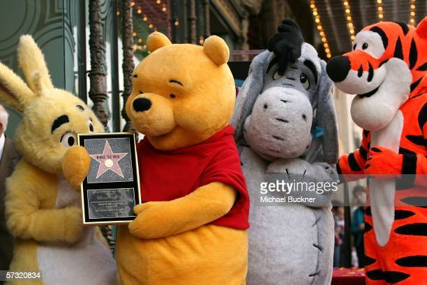 Rabbit Winnie The Pooh Eeyore and Tigger pose for photos as Winnie The Pooh receives a star on the Hollywood Walk of Fame in front of the El Capitan...