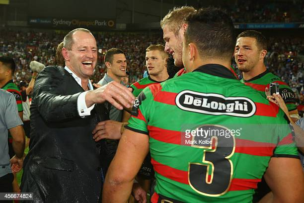 Rabbitohs coach Michael Maguire celebrates with Dylan Walker of the Rabbitohs during the 2014 NRL Grand Final match between the South Sydney...