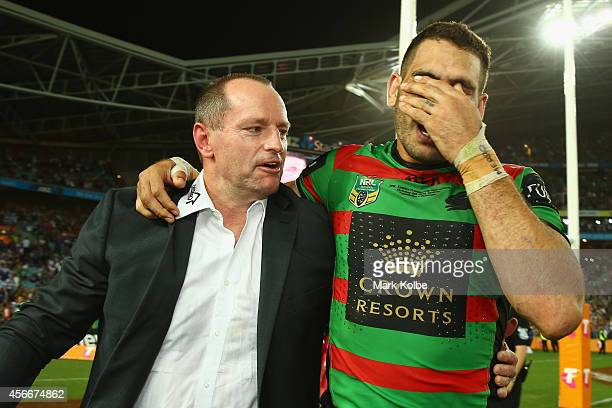 Rabbitohs coach Michael Maguire celebrates with Greg Inglis of the Rabbitohs after victory during the 2014 NRL Grand Final match between the South...