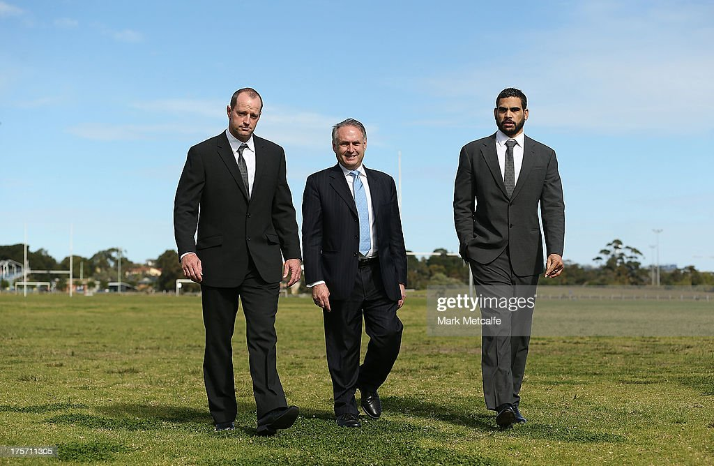 Rabbitohs coach Michael Maguire, Federal Minister for Sport Senator Don Farrell and Greg Inglis pose during a South Sydney Rabbitohs NRL media announcement at Heffron Park on August 7, 2013 in Sydney, Australia.