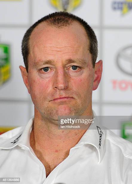 Rabbitohs coach Michael Maguire looks on during the post match press conference during the round 16 NRL match between the North Queensland Cowboys...