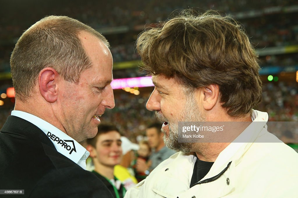 Rabbitohs coach Michael Maguire speaks to Russell Crowe after victory during the 2014 NRL Grand Final match between the South Sydney Rabbitohs and the Canterbury Bulldogs at ANZ Stadium on October 5, 2014 in Sydney, Australia.