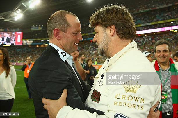Rabbitohs coach Michael Maguire speaks to Russell Crowe after victory during the 2014 NRL Grand Final match between the South Sydney Rabbitohs and...