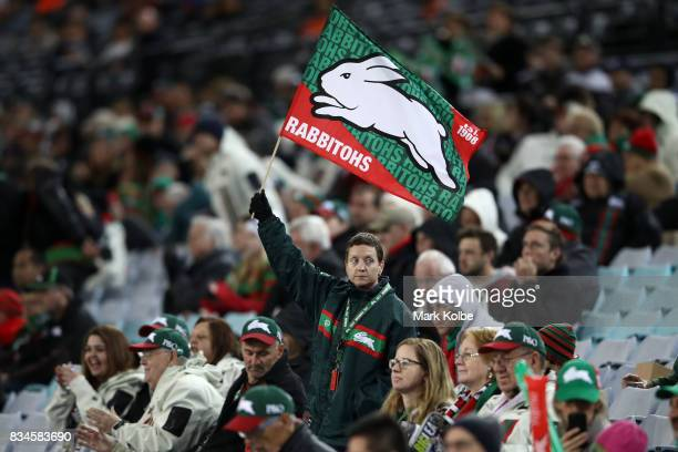 Rabbitohs fan waves a flag during the round 24 NRL match between the South Sydney Rabbitohs and the New Zealand Warriors at ANZ Stadium on August 18...