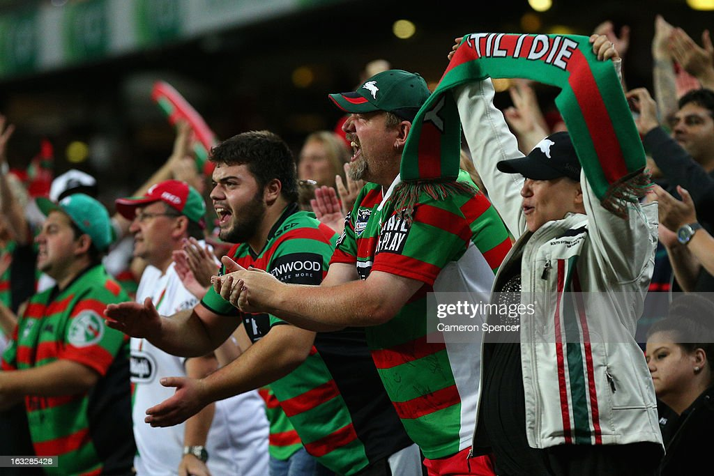 Rabbitohs fans celebrates a try during the round one NRL match between the Sydney Roosters and the South Sydney Rabbitohs at Allianz Stadium on March 7, 2013 in Sydney, Australia.