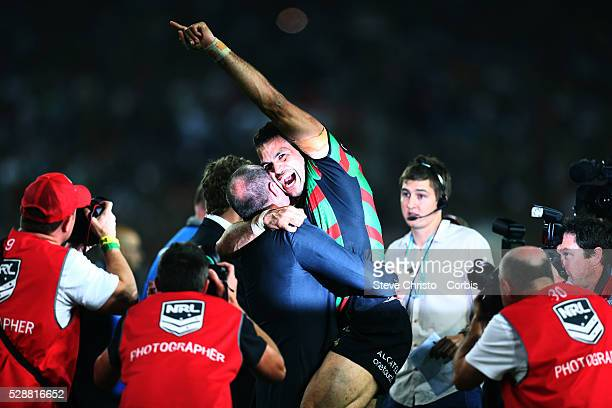 Rabbitohs Greg Inglis and coach Michael Maguire celebrate after beating the Bulldogs 30 to 6 in the NRL Grand Final match at ANZ Stadium 2014 Sydney...