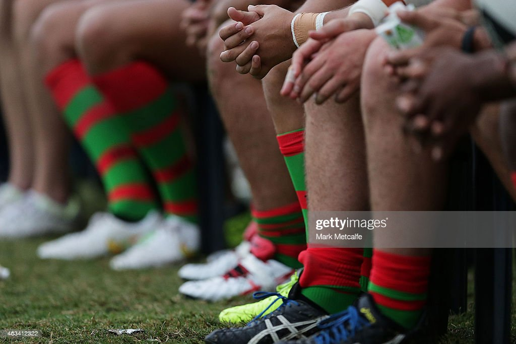 Rabbitohs players are seen on the substitutes bench during a NRL preseason match between the South Sydney Rabbitohs and the Northern Pride at Redfern...