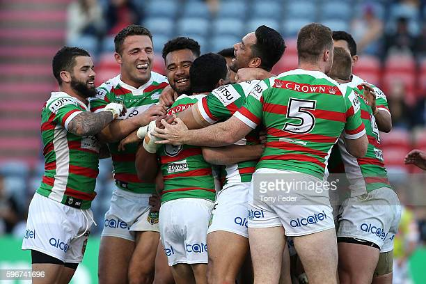 Rabbitohs players celebrate a try during the round 25 NRL match between the Newcastle Knights and the South Sydney Rabbitohs at Hunter Stadium on...