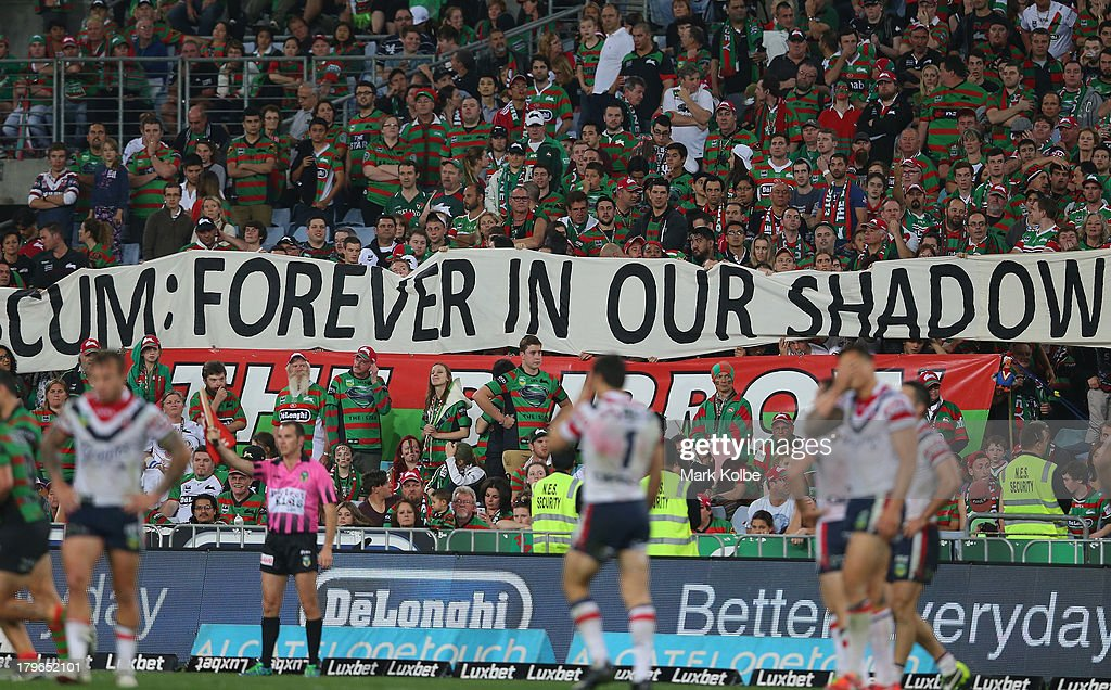 Rabbitohs supporters in the crowd hold up a banner during the round 26 NRL match between the South Sydney Rabbitohs and the Sydney Roosters at ANZ Stadium on September 6, 2013 in Sydney, Australia.