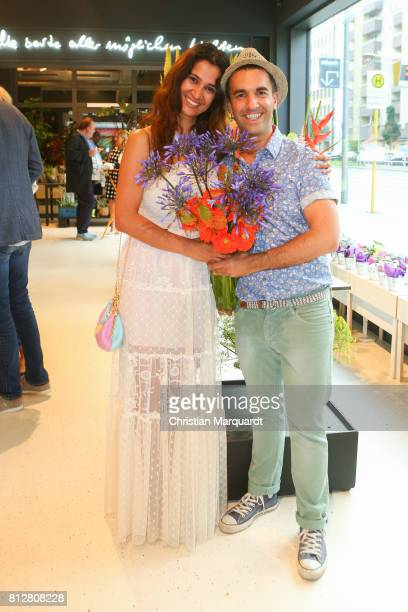 Rabeah Rahimi and Kian ShamsDolatabadi attend the 'Kians Garden Flower Shop' Opening Event at Kantstrasse on July 11 2017 in Berlin Germany