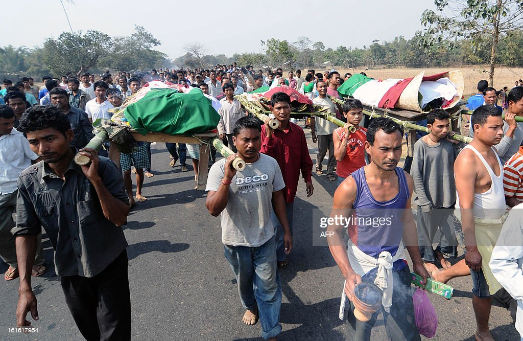 Rabha tribals participate in a funeral procession as they carry the mortal remains of those killed by violence, along National Highway-37 in Darrangi Kasadol village in Goalpara, some 135 km from Guwahati in India's northeastern state of Assam, on February 13, 2013. India deployed hundreds of troops and imposed a curfew on Wednesday as the death toll from electoral violence in the northeastern state of Assam climbed to 20. AFP PHOTO/BIJU BORO