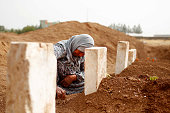 Rabia Mustafa Ali mourns by the grave of her son Seydo Mehmud Cumo a People's Protection Unit fighter who killed during clashes with ISIS in Kobani...