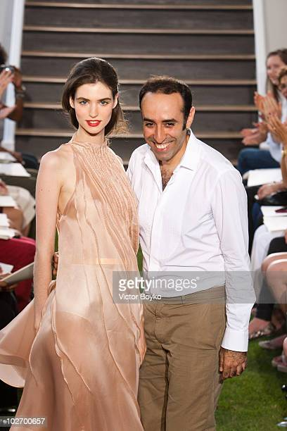 Rabih Kayrouz and model walk the runway of the Maison Rabih Kayrouz show as part of Paris Fashion Week Fall/Winter 2011 at on July 7 2010 in Paris...