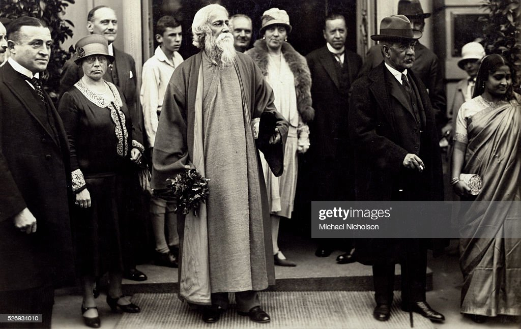 <a gi-track='captionPersonalityLinkClicked' href=/galleries/search?phrase=Rabindranath+Tagore&family=editorial&specificpeople=644181 ng-click='$event.stopPropagation()'>Rabindranath Tagore</a>, the 1913 recipient of the Nobel Prize in Literature, standing in a group.