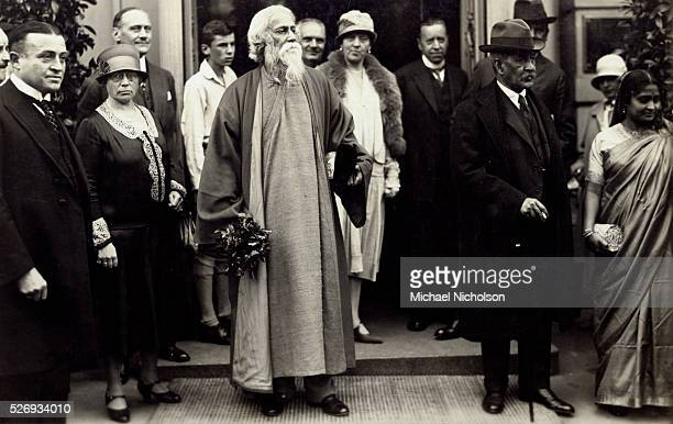 Rabindranath Tagore the 1913 recipient of the Nobel Prize in Literature standing in a group