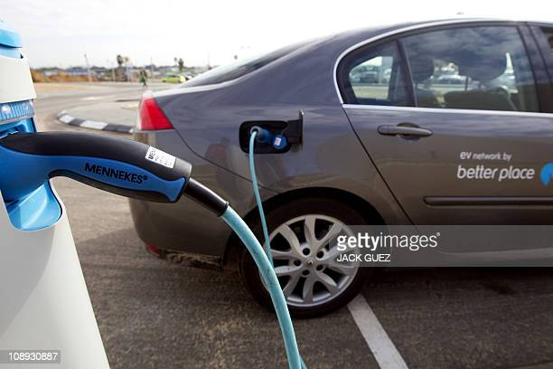 RABINOWITZAn electric car rechrages its battery from a stand at the parking of Better Place a electric vehicle services provider in Glilot north of...